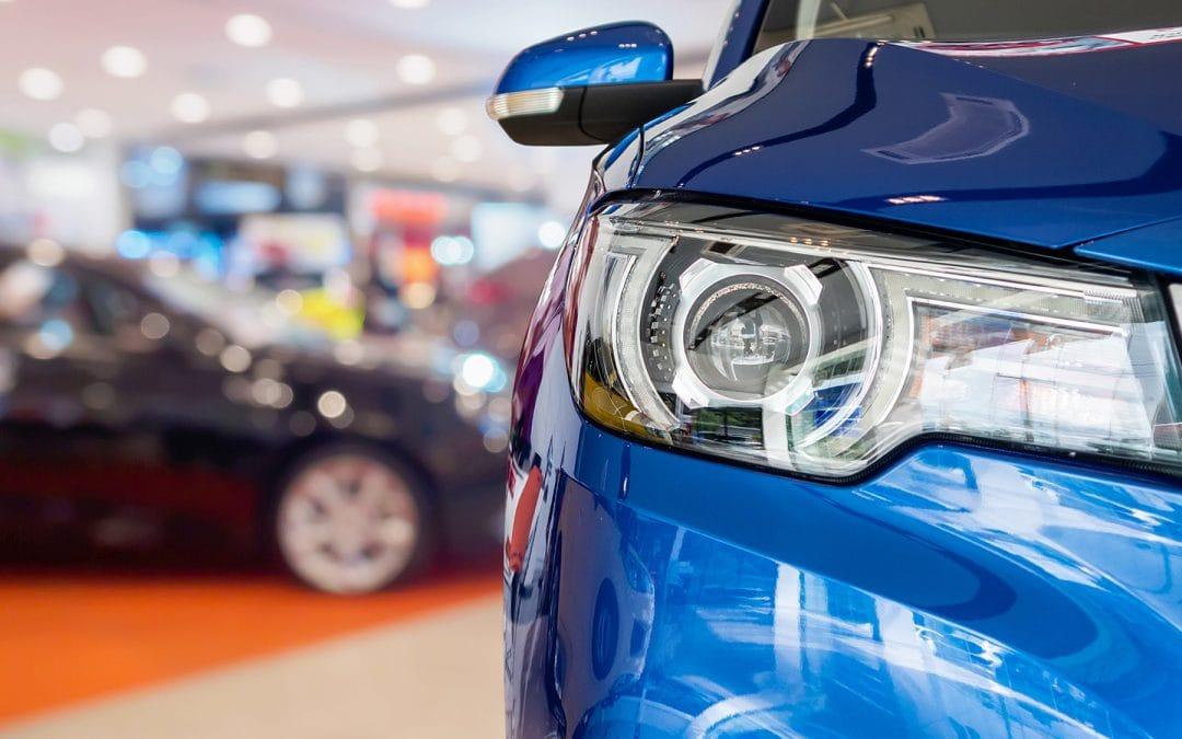 new cars in SEMA showroom interior background